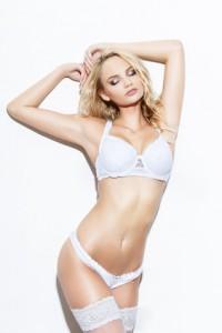 Sexy blonde woman posing in white underwear